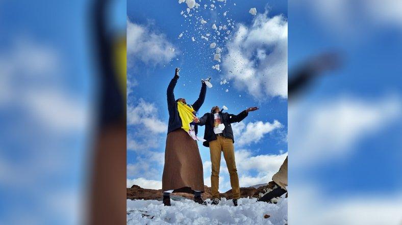 Playing in snow in Saudi