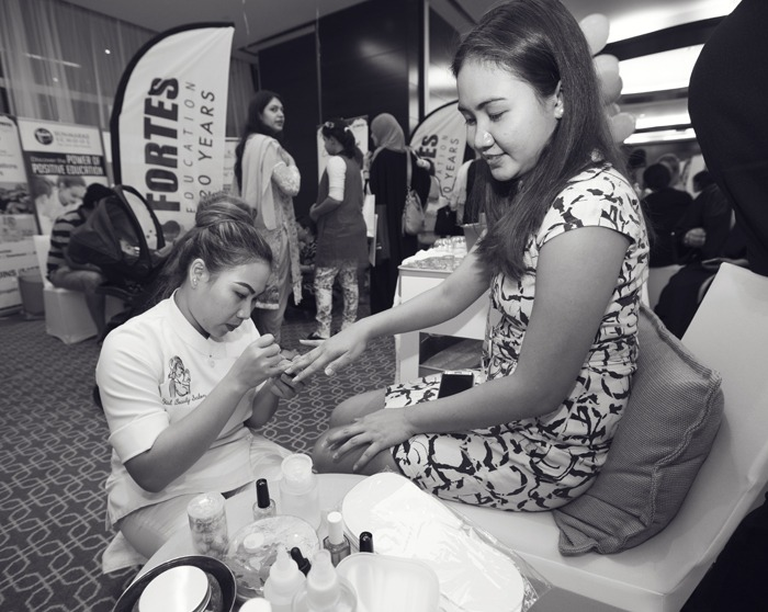 Ladies were offered treatments like manicures and hair-braiding from some of the great companies present
