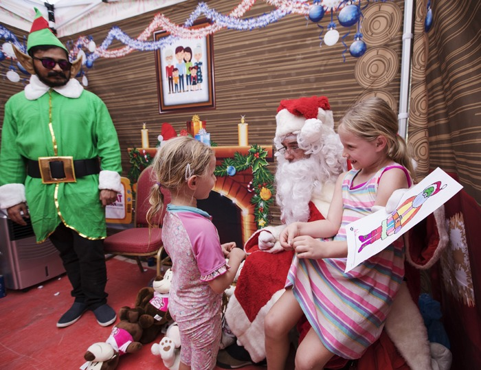 Santa had his helpful elves with him on the day, too!