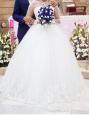Gorgeous designer lace wedding gown